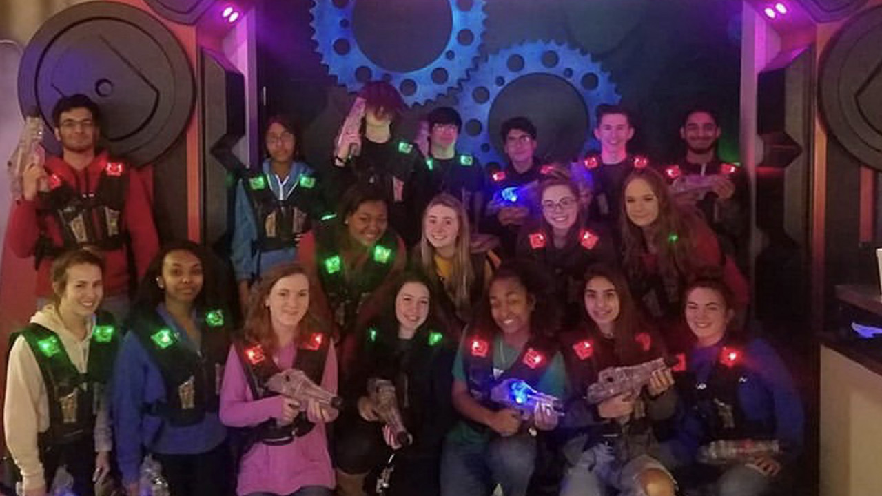 Group of teens playing laser tag